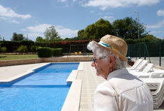 A senior lady at the outdoor  pool side Royalty Free Stock Photo