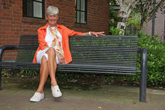 Senior lady in the park Royalty Free Stock Photos