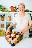 Senior lady with pickled food. Vegetables cucumbers tomatoes Stock Images