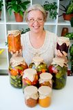Senior lady with pickled food. Vegetables cucumbers tomatoes Royalty Free Stock Image
