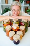 Senior lady with pickled food. Vegetables cucumbers tomatoes Royalty Free Stock Photography