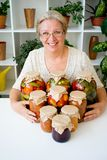 Senior lady with pickled food. Vegetables cucumbers tomatoes Royalty Free Stock Images