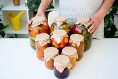 Senior lady with pickled food Stock Photos