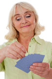 Senior lady playing cards. Royalty Free Stock Photo