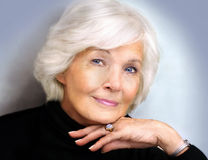 Senior lady with polo neck. Beautiful senior lady with black polo-neck,looking wise Stock Photography