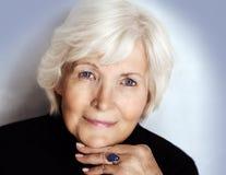 Senior lady with polo neck stock photo