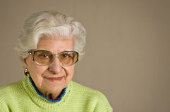 Senior lady portrait,  glasses, with copy space. Royalty Free Stock Image