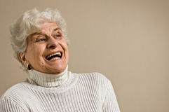 Senior lady portrait, laughing, copy space. Stock Image