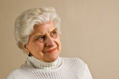 Senior lady portrait, smiling, with copy space. stock images