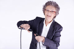 Senior lady with power cable Stock Photography