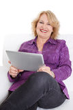 Senior lady reading e-book Stock Images