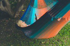 Senior lady relaxing in a hammock Stock Photography