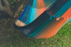 Senior lady relaxing in a hammock Stock Images