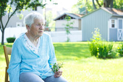Senior lady relaxing outside in spring day Stock Image