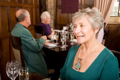 Senior lady in restaurant Stock Images