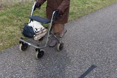 senior lady with rollator on a bikeway stock photography