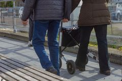 Senior lady with rollator. In city park south germany, assistance, care, disability, disabled, elderly, garden, grandmother, grandparents, health, mobility, old stock images
