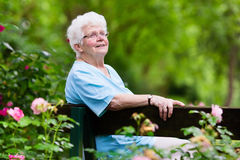 Senior lady in rose garden Royalty Free Stock Photography