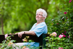 Senior lady in rose garden Royalty Free Stock Images