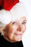 Senior lady with santa hat stock photography