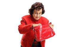Free Senior Lady Searching Through Her Bag Royalty Free Stock Image - 122198216