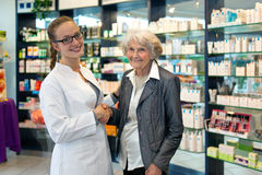 Senior lady shaking hands with a pharmacist Royalty Free Stock Image
