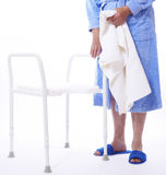Senior lady beside shower seat Stock Photos