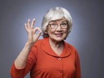 Senior lady showing ok sign Stock Image
