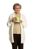 Senior Lady Smiling Holding a Cup of Coffee Royalty Free Stock Photos