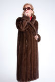 Senior lady  smoking with mink coat b Royalty Free Stock Photos