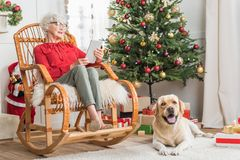 Senior lady is spending time with her pet Royalty Free Stock Image