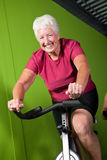 Senior lady spinning Stock Photography