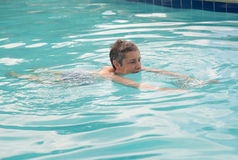 Senior lady swimming in pool royalty free stock image