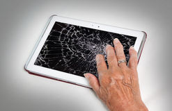 Senior lady with tablet, cracked screen. Concept of insurance stock image