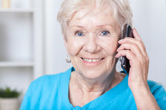 Senior lady talking on cellular phone Stock Photos