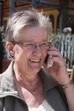 Senior lady talking on iphone Stock Images
