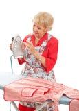 Senior Lady Tests Iron Stock Photos