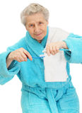 Senior lady with toothbrush Royalty Free Stock Photo