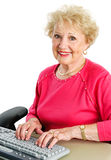 Senior Lady Using Desktop Computer Stock Images