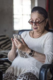 Senior lady using her smart phone Stock Photo