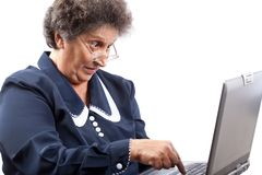 Senior lady using laptop. Old woman with glasses using computer Stock Photo