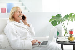 Senior lady using modern technology on vacation Royalty Free Stock Images