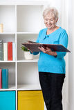 Senior lady viewing family album Royalty Free Stock Images
