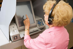Senior Lady Votes on Touch Screen Stock Photography