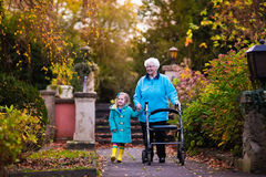 Senior lady with walker enjoying family visit Royalty Free Stock Images