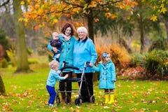 Senior lady with walker enjoying family visit Royalty Free Stock Photos