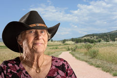 Senior lady wearing a black cowboy hat Stock Photos