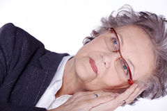 Senior lady wearing glasses is tired Stock Photos