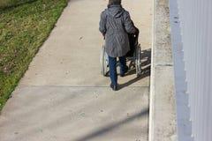 senior lady with wheelchair royalty free stock photos