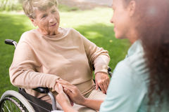 Senior lady on wheelchair stock image